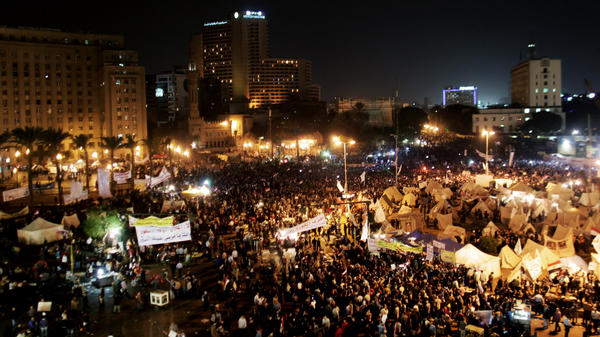 Protesters gather in Tahrir Square in Cairo, Egypt, on Tuesday. Tens of thousands of Egyptians also gathered outside the presidential palace in Cairo in demonstrations that turned violent as tensions grew over President Mohammed Morsi's seizure of nearly unrestricted powers.