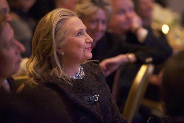 Secretary of State Hillary Clinton watches a video about her public life that was played before she addressed the Saban Forum in Washington last week.