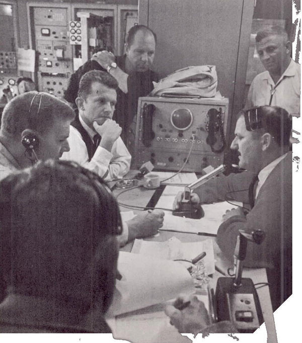 In the California receiver control room, personnel await confirmation that Mariner has begun to scan the planet Venus.