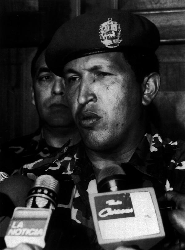 As a lieutenant colonel in 1992, Chavez led a failed attempt to oust President Carlos Andres Perez. Here he speaks with reporters at the Defense Ministry after he surrendered to troops loyal to the president.