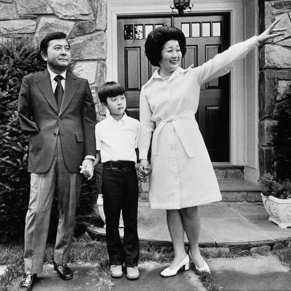Inouye's wife, Maggie, waves to a neighbor as she, the senator and son Kenny prepare to leave their home, Aug. 4, 1973, in Bethesda, Md.