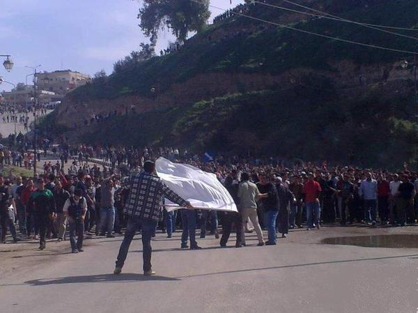 In March 2011, at the beginning of the Syrian uprising, protester Ibrahim Abazid made a massive white flag out of a sugar sack. This picture of him waving the flag in his hometown of Dera'a became a hugely popular image. Now Abazid hopes to serve on a city council in Dera'a.