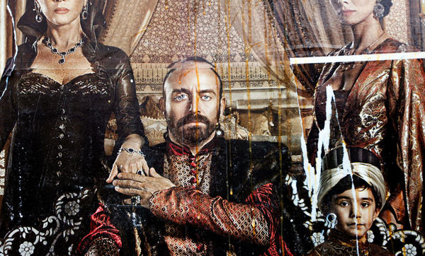 Eggs streak down a billboard advertising the popular Turkish soap opera <em>The Magnificent Century. </em>The show focuses on palace intrigue during the 16th-century rule of Suleiman the Magnificent. Some Islamists have protested the show's depiction of the sultan's harem.