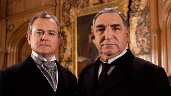 Hugh Bonneville (left) stars as Lord Grantham and Jim Carter as Mr. Carson, the formidable butler of <em>Downton Abbey</em>.