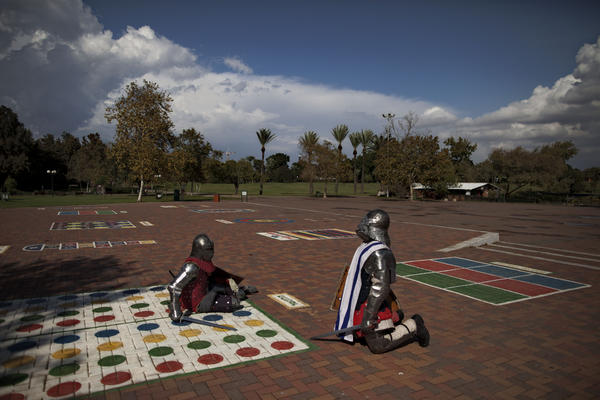 Immigrants from the former Soviet Union practice sword-fighting in full knight armor at a public park in Ramat Gan, central Israel. Medieval combat simulation is popular in ex-Soviet countries, and some immigrants have continued the hobby in Israel.