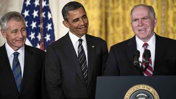 John Brennan speaks in the East Room of the White House on Monday, after President Obama announced his nomination of Brennan to run the CIA. Obama also announced his choice of former Sen. Chuck Hagel (left) to head the Department of Defense.