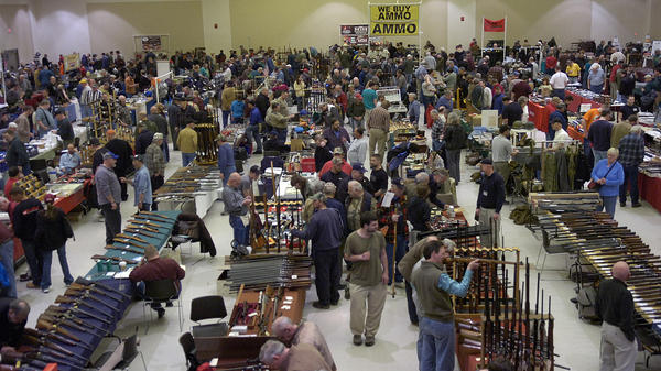 Gun enthusiasts flock to the New Eastcoast Arms Collectors Associates Arms Fair in March 2012 in Saratoga, N.Y. Some local residents would like the next show to be canceled, in light of the Newtown, Conn., school shootings.