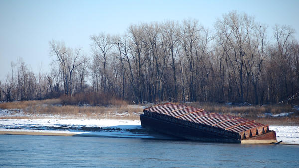 The river has fallen fast enough that barges have been beached along its banks outside St. Louis.