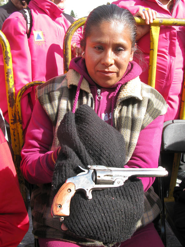 In Mexico City, Sara Martinez Franco holds a .38-caliber revolver that belonged to her grandfather. She traded in the weapon — which she says was used during the Mexican Revolution — under the buyback program.