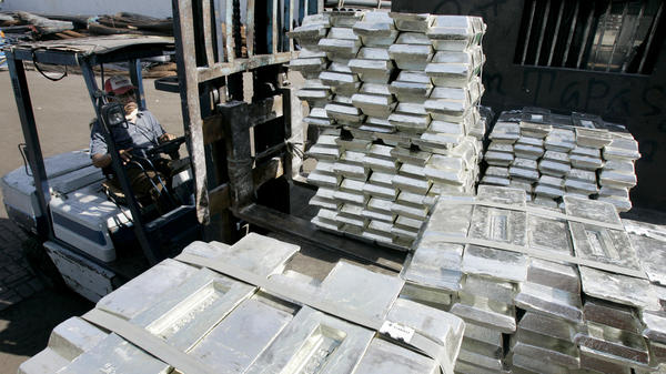 This port worker in Indonesia is moving tin ingots around a dock. But he probably wishes these big bars were made of platinum instead. Then, they'd be worth about $26,000 per pound.