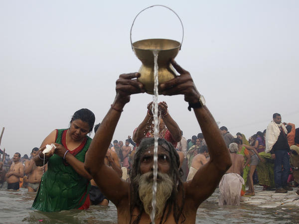 "Hindu devotees prayed and washed as they attended the first ""Shahi Snan"" (grand bath) at the opening of the Kumbh Mela festival today in Allahabad, India."
