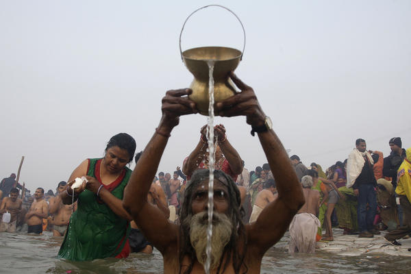 Devotees pray and wash as they attend the first Shahi Snan, or grand bath. Up to 100 million worshippers will gather at the Kumbh Mela over the next 55 days to take a ritual bath in the holy waters, believed to cleanse sins and bestow blessings.