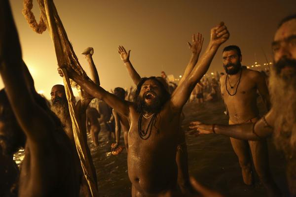 Naga Sadhus celebrate naked in the water at Sangam.