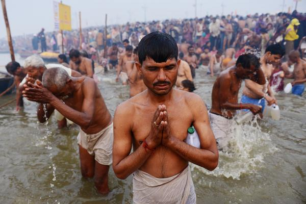 Hindu devotees pray at the Sangam, or confluence, of the Yamuna and Ganges rivers during the Kumbh Mela festival in Allahabad, India, on Monday.