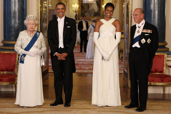 <strong>Diplomacy with style:</strong> The Obamas pose with Queen Elizabeth II and Prince Philip at Buckingham Palace ahead of a state banquet on May 24, 2011. Michelle's gown was designed by American fashion designer Tom Ford.