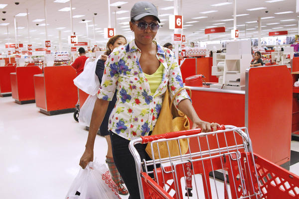 <strong>Typical American:</strong> Michelle leaves a Target department store in Alexandria, Va., after doing some shopping on Sept. 29, 2011. Her style choices range from expensive, high-end designers to discount stores like Target.