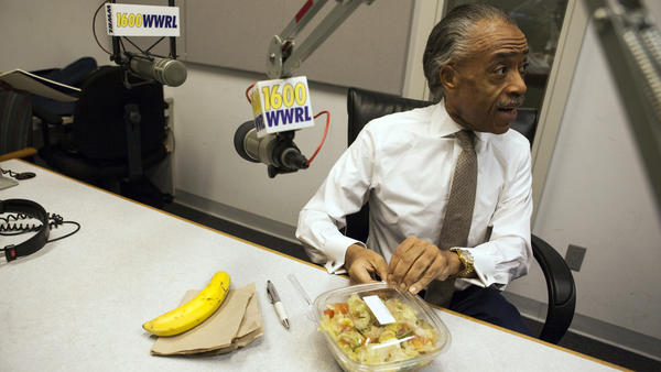 """Sharpton eats his lunch, which consists of a banana, salad, and lemon tea before his radio show """"Keeping It Real with Reverend Al Sharpton"""" in New York."""