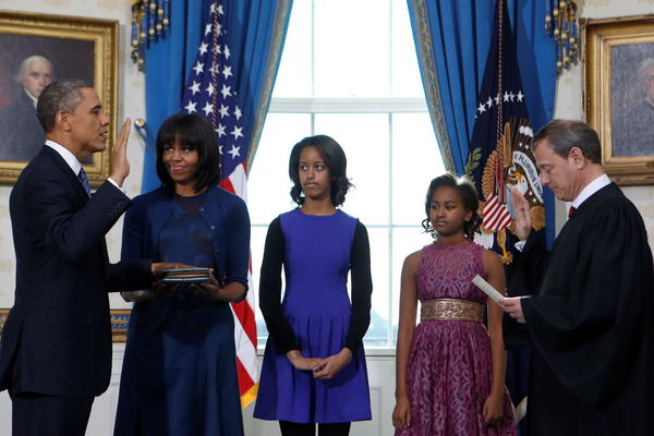 On Sunday, during the official swearing-in ceremony at the White House, the first lady wore a dress and cardigan by Reed Krakoff. <em>Women's Wear Daily</em> reports she wore the same cardigan on Monday.