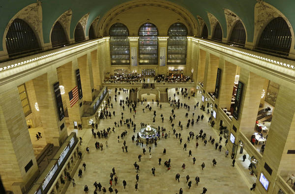 Travelers cross the main concourse of New York's Grand Central Terminal in January. The terminal marks its 100th anniversary on Feb. 2.