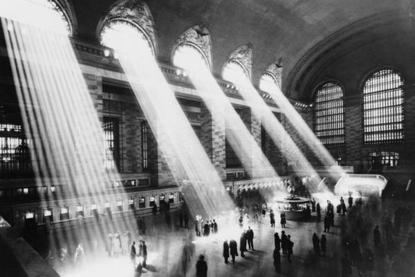 Beams of sunlight stream through the windows of Grand Central Terminal, circa 1930.