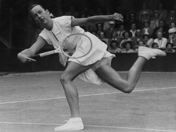 "Gertrude Moran, ""Gorgeous Gussie,"" playing at Wimbledon in 1949. Her attire, which included a bit of lace, shocked some."