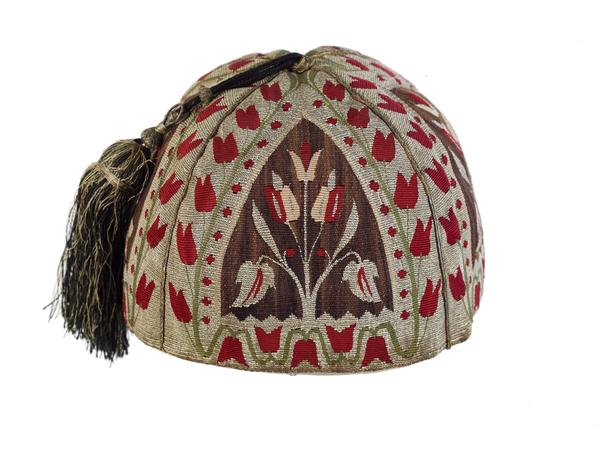 The silken tassel on this skull cap, woven in Aleppo around 1800, recalls a more prosperous and tranquil time in that now-beleaguered Syrian hub.