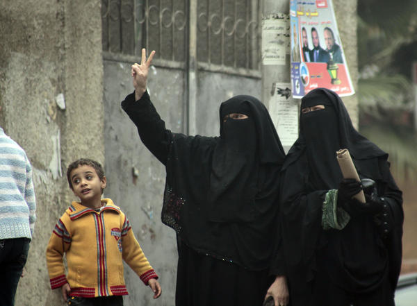 Female supporters of the Nour Party flash victory signs outside a polling station in Cairo on Jan. 30, 2012.