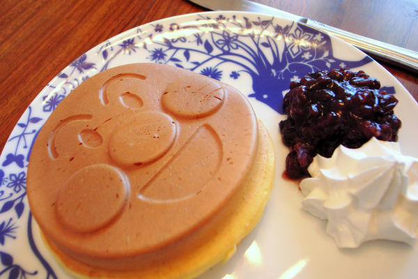 Food imitates art imitating food: a pancake shaped to resemble Anpanman's sweet roll head.
