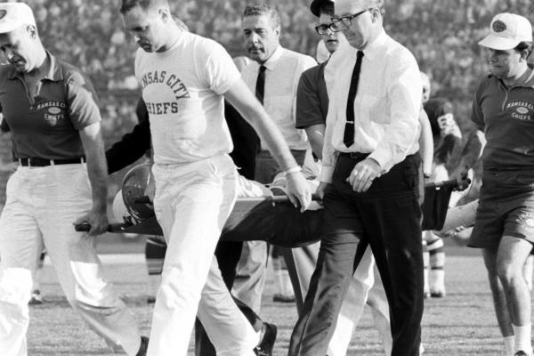 """Kansas City's injured Fred """"The Hammer"""" Williamson is carried off the field."""