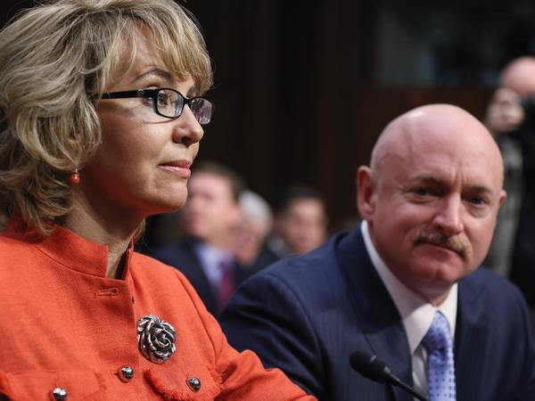 Former Rep. Gabby Giffords, D-Ariz., and her husband Mark Kelly at Wednesday's Senate hearing about gun violence.