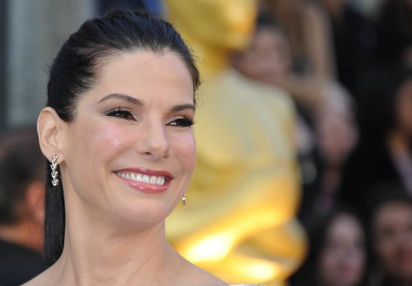 This is Sandra Bullock at the 2012 Oscars. Sunday, she's watching the Super Bowl.