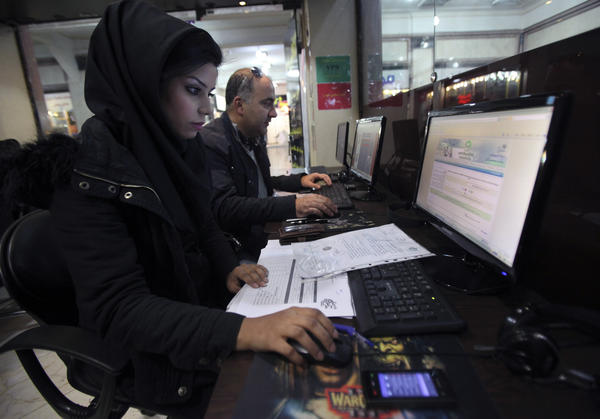 Iranian authorities are using cyberpolice units to crack down on people who try to access banned websites, including social media sites such as Facebook. Here, Iranians use computers at an Internet cafe in Tehran in January.
