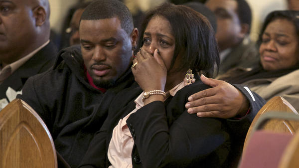 Shirley Chambers cries during Monday's funeral for her son Ronnie Chambers, 33. She had four children, three boys and a girl, all victims of gun violence in Chicago over a period of 18 years.