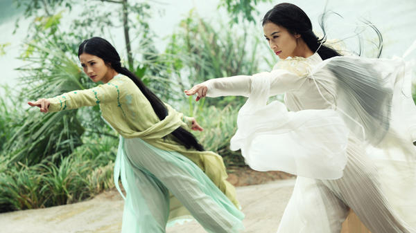 The demon snake sisters (Charlene Choi and Eva Huang) disguise themselves as beautiful women in <em>The Sorcerer and the White Snake.</em>