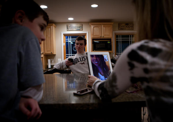 """<a href=""""http://www.npr.org/templates/story/story.php?storyId=171598750"""">The Jordans use an iPad to talk to their daughter, Kelly, who's at school in Pennsylvania.</a>"""