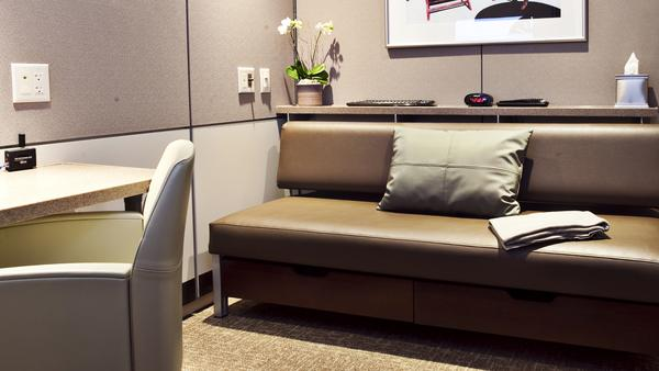 Minute Suite's 7-by-8-feet rooms offer Wi-Fi, a sofa bed, a television and a workspace. One traveler compared the small spaces to having an MRI done, but others say the idea is overdue at Chicago's O'Hare International Airport.