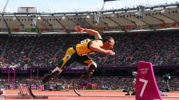 Oscar Pistorius of South Africa leaves the starting blocks of the men's 400-meter race at the 2012 London Olympics.