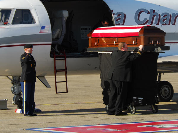Tracy met Donna's coffin when it arrived in Fort Bragg, N.C.