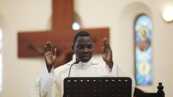 Priest Anthony Obanla says Mass at a church in Lagos, Nigeria. In Africa, where the Catholic Church continues to grow, worshipers and clergy hope to see one of their own rise to lead the faithful.