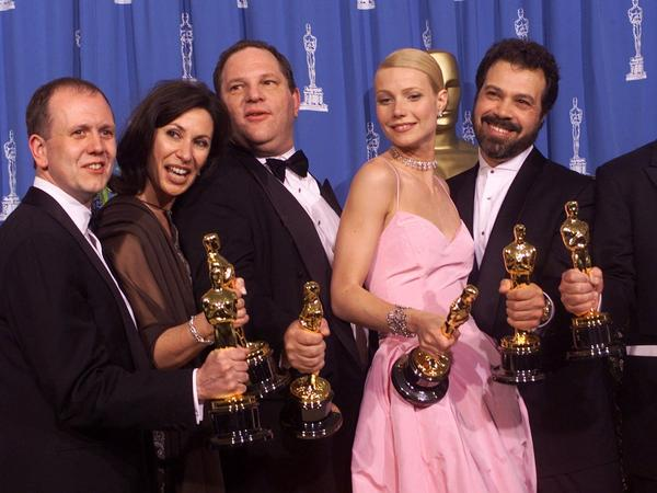 Producers and cast celebrate after winning best picture for <em>Shakespeare in Love</em> during the 71st Annual Academy Awards.