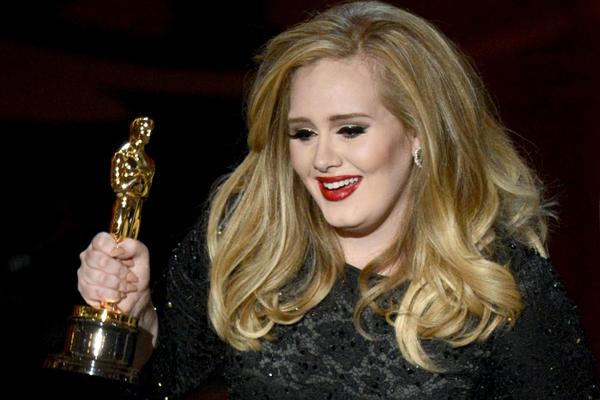 "Adele accepts the Oscar for best original song — the theme song in ""Skyfall."""