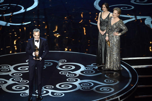 "Daniel Day-Lewis accepts the Oscar for best actor for his role in ""Lincoln."""