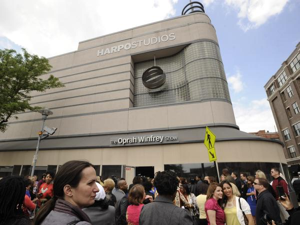 Members of the studio audience wait outside Harpo Studios before the final taping of <em>The Oprah Winfrey Show</em> in Chicago in May 2011.