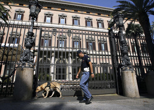 An Italian security policeman checks the main entrance of the U.S. Embassy in downtown Rome in 2008, ahead of a visit by President George W. Bush. The embassy building is over 300 years old and was once the home to the first queen of Italy, Margherita.