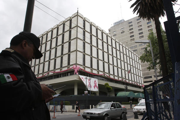 A policeman stands in front of the U.S. Embassy in Mexico City in 2008. This embassy was built in 1961 and is more in line with the fortress-style embassies.