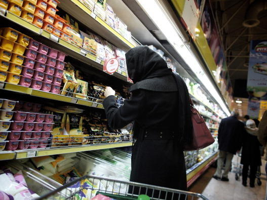 An Iranian woman shops at a supermarket in the capital, Tehran, on Feb. 22. International sanctions have hurt Iran's economy, but prospects for a breakthrough on Iran's nuclear program are dim as negotiators meet in Kazakhstan.