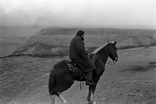 Vietnam veteran, Sid Mills, a Yakima man, stands guard.