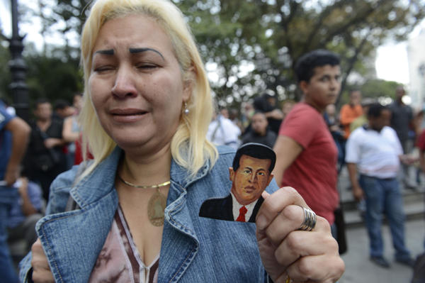 A supporter of Venezuelan President Hugo Chavez cries after learning of his death in Caracas on March 5, 2013.