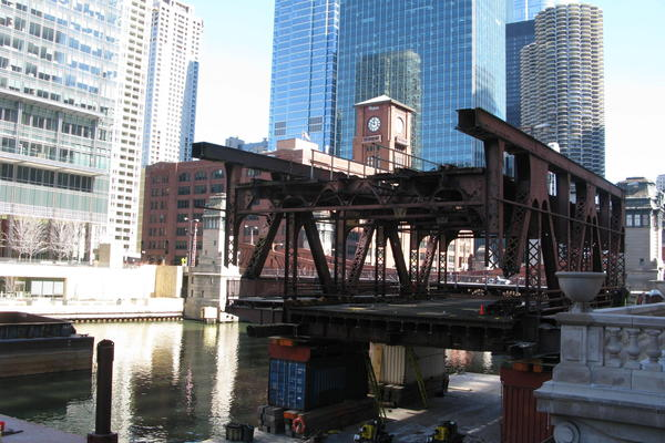 The south leaf section of the Wells Street Bridge in Chicago has been cut off, and will be floated on the river to make way for the replacement section.