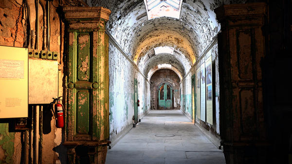 A hallway at Eastern State Penitentiary in Philadelphia. The prison, opened in 1829 and closed in 1970, pioneered the use of solitary confinement.